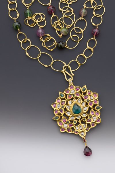 "Jewel of the Lotus: An antique 20K-22K Mughal-style pendant depicting Lakshmi in the lotus garden. Small pink tourmaline cabochons & table-cut diamonds surround a large center green tourmaline cabochon. On 39 luscious inches of hand-made fused 18K chain sprinkled w/ multi-hued faceted tourmalines. Reversible pendant has traditional enameled back. Pendant length w/faceted pink tourmaline drop, 3"". #ancientsplendor #amulet #lakshmi #gemofthelotus #18K 22K #necklace #tourmaline #jewelry…"