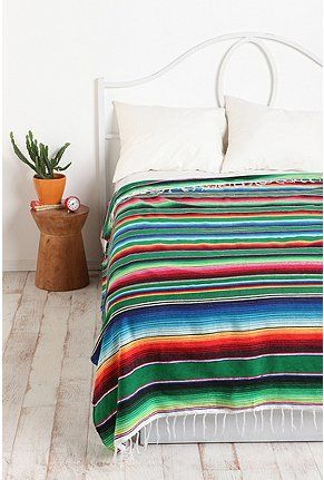 Simple guest bedroom set up with classic southwestern/mexican with a clean, modern finish