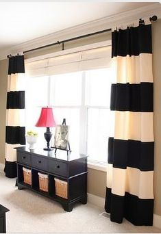 I like the look of these black and ivory curtains.
