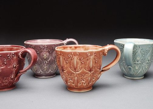 """A neo-Victorian, Art Nouveau-inspired handled cup that provides daily elegance for your morning coffee or tea. I glazed this cup in a satin salmon pink/brown with a glossy interior version of the same.    **As seen in the January 2011 issue of Cottages & Bungalows' """"In Vogue"""" article about Art Nouveau!**    I throw this form on the potter's wheel and then use a stamp I design and make to impress and alter the surface of the cup. My fingerprint is on the other side of each one of the…"""