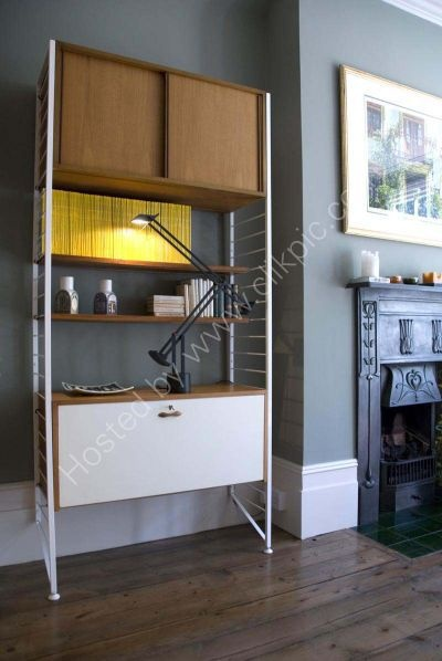 We have Ladderax, but with black uprights. We don't have the white lower cabinet which I covet.