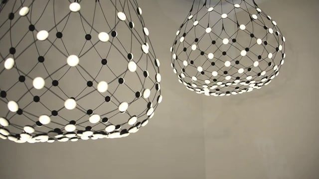 A suspension lamp offering multiple lighting scenarios for personalized aesthetic and functional performance. Based on experimentation with the potential of LEDs, a technology that permits separation into very small units, Mesh is a dramatic and highly innovative project.