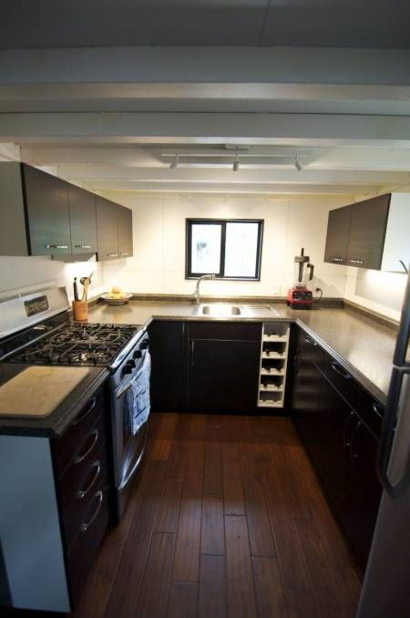350 Square Feet For $22k: The Tiniest, Most Brilliant Home We've Seen--here's a picture of the tiny house's kitchen, not bad!