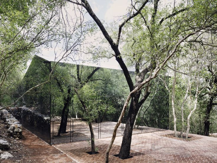The larger volume has a peaked roof and a mirrored facade. Tagged: Exterior, House, and Glass Siding Material. Photo 2 of 16 in A Mirrored Mexican Home Hides Among a Lush Forest from This Mirrored Mexican Home Hides Among Trees