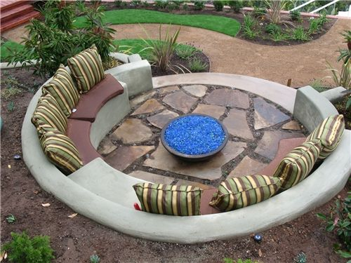 Semi circular shape seating area outdoor space for Built in fire pits designs
