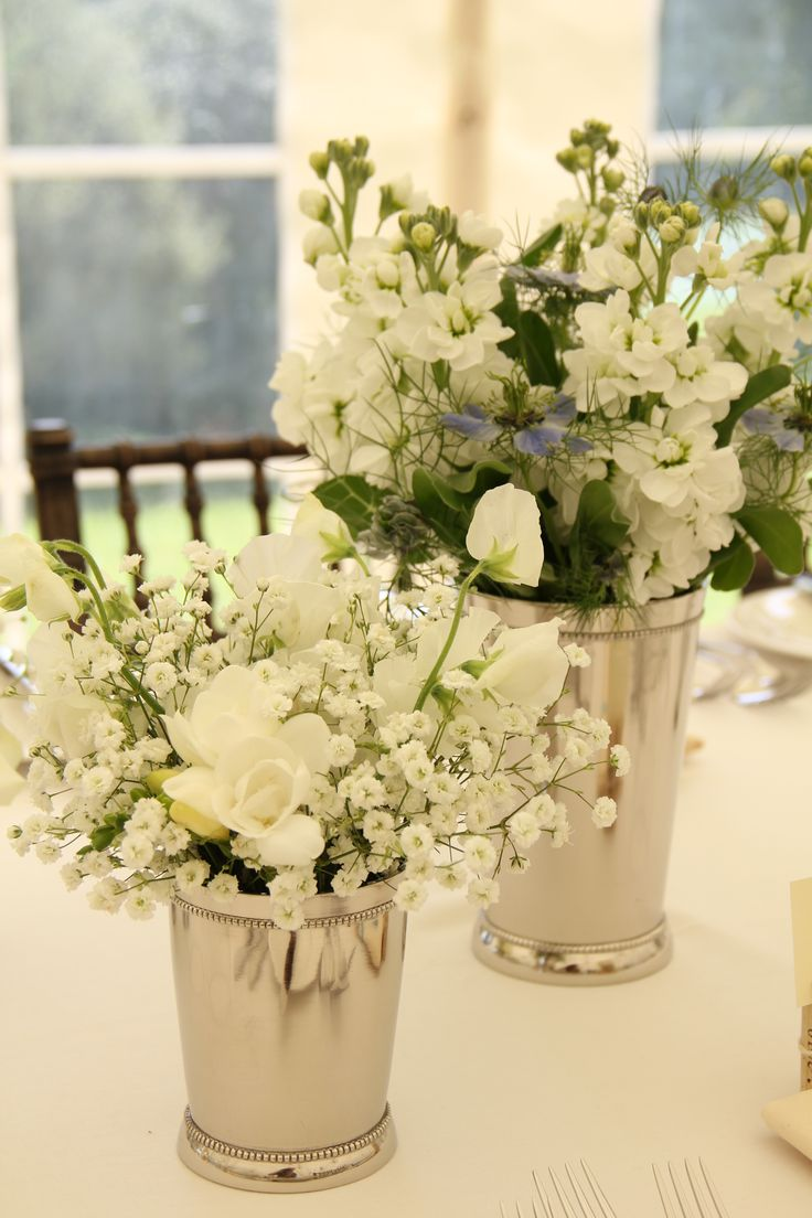 Clusters of silver vases to line the tables