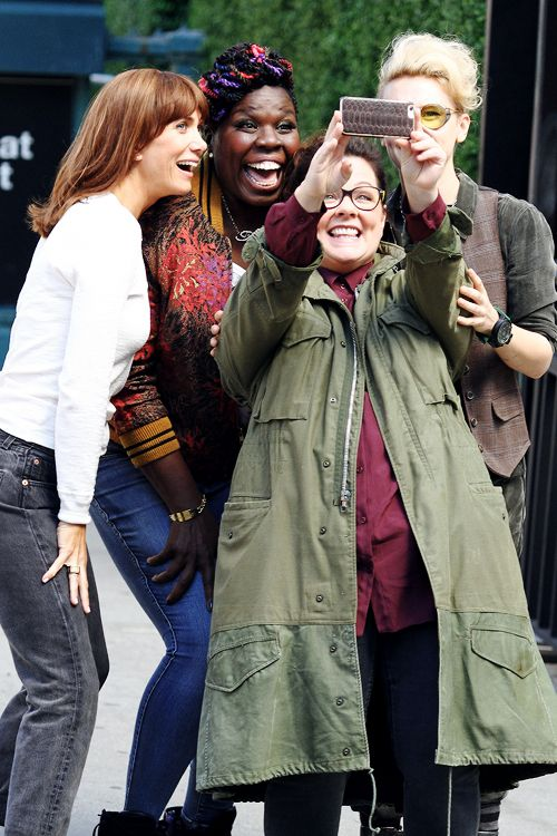 Ghostbusters (2016) main cast taking a selfie, in costume