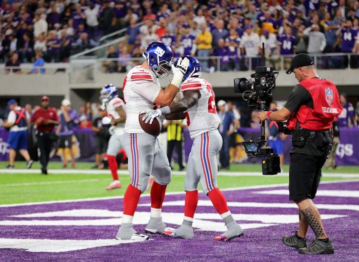 Monday Night Football: Giants vs. Vikings:   October 3, 2016  -  24 - 10, Vikings  -    Orleans Darkwa of the New York Giants celebrates his touchdown in the second half of the game against the Minnesota Vikings on Oct. 3, 2016 at U.S. Bank Stadium in Minneapolis.