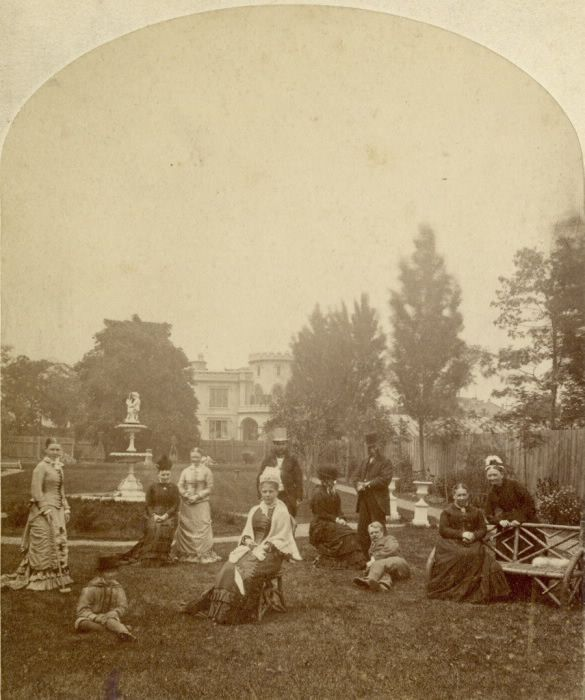 Historic photo from 1880 - Queens Hotel - guests by the fountain at east side, showing Holland House in background in Financial District