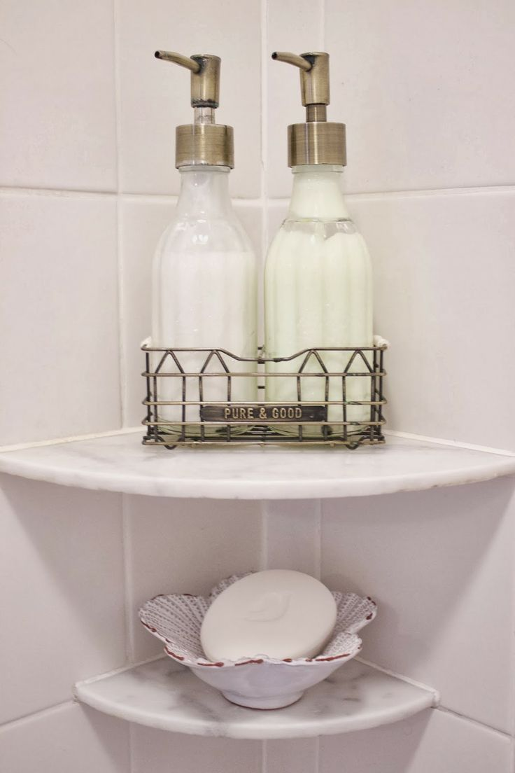 shampoo and conditioner in glass bottles