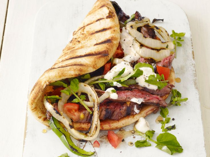 Grilled Skirt Steak Gyros : Keep steak casual with this Greek-inspired sandwich. Top the olive oil-, garlic- and oregano-marinated steak with a cool yogurt sauce.