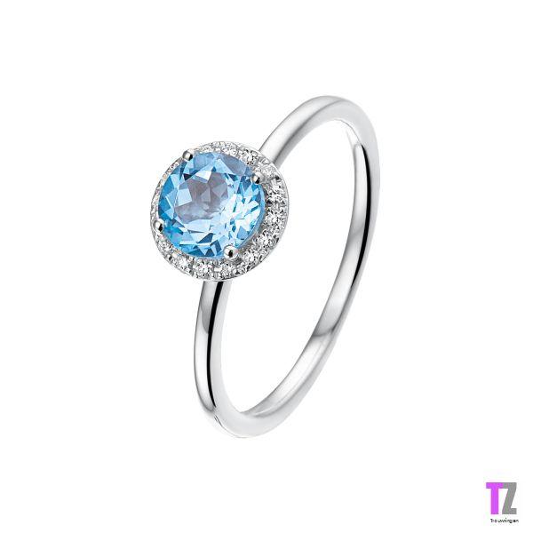 Verlovingsring/aanzoekring in witgoud met blauwe topaas en diamant. Kijk op www.trouwringen-zwolle.nl/verlovingsringen voor meer modellen
