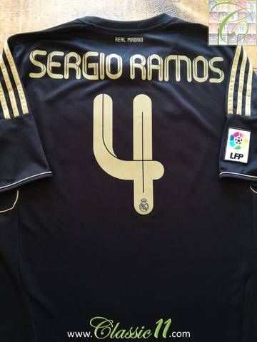 Official Adidas Real Madrid away football shirt from the 2011/2012 season. Complete with Sergio Ramos #4 on the back of the shirt and La Liga patch on the sleeve.