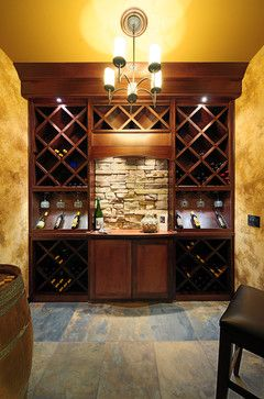 Butler Pantry - I like the small, but bold aspect, especially with the barrel; however, I would use less wine wracks and more cabinetry.