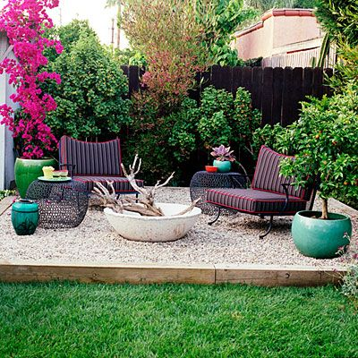 "Den: Vintage wrought-iron chairs, rusted metal side tables, and brown cushions make this space invitingly casual and play off the deep brown fence behind. A purple hop bush provides hits of red and orange. Raised a few inches above the dining area, the den's floor is covered with pea gravel. A potted bougainvillea beside the garden shed adds vibrant magenta to this ""room."""