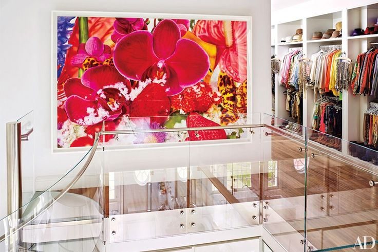 A multilevel dressing room is brightened by a Marc Quinn artwork | archdigest.com