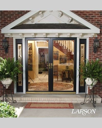 This traditional home has an entry with big impact, thanks to the double doors and black storm doors that let in lots of light and give the owners a view out.   #WelcomeHome #MyLarsonDoor