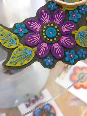 cut out an interesting belt shape in felt and appliqué flowers and leaves, then add embroidery and beads