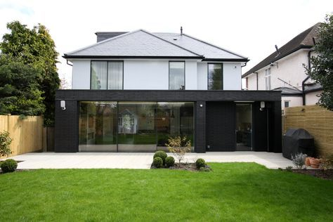 minimal windows used as modern patio doors to rear extension in Richmond