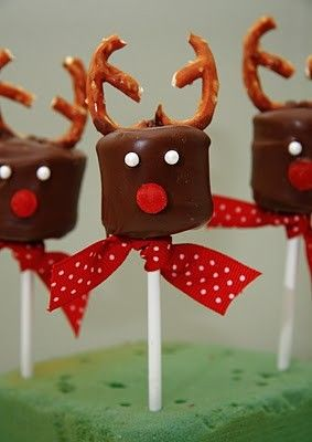 Reindeer marshmallow pops    Here's what you need:  Large Marshmallows (I prefer Jet-Puffed over the store brand)  Lollipop sticks, popsicle sticks, or pretzel sticks  Ribbon  Melting Chocolate (I prefer the ones you buy at the craft store for their smooth texture)  Cinnamon dots, Hot Tamales or Mike & Ike's Reds  Small Pretzels  Pearl Sprinkles (o