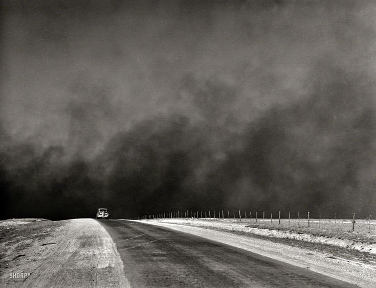 "March 1936. ""Heavy black clouds of dust rising over the Texas Panhandle"" — evidence of the forces that were driving thousands of farm families in Texas and Oklahoma to the West Coast in the great Dust Bowl migration chronicled in ""The Grapes of Wrath."" Medium format negative by Arthur Rothstein. View full size."