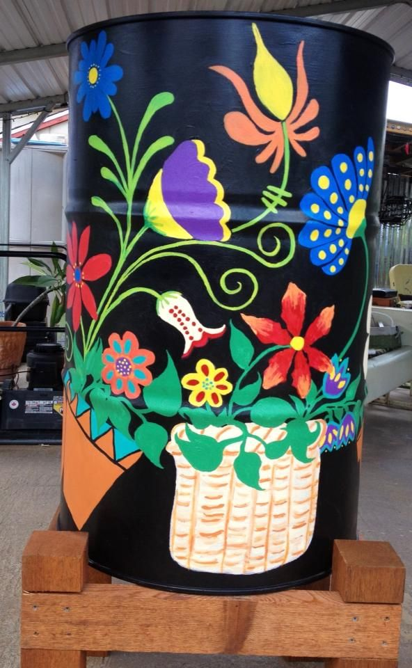I painted this rain barrel for an auction. Fits right at home with all the other plants!