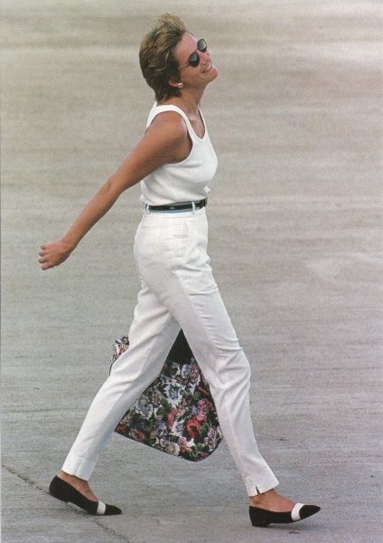 Update: Princess Diana age 33 (German newspaper article). Thus Circa 1994. Princess Diana in white slacks and vest, and loafers. Another photo of Diana in this outfit was at the airport, with 2hat looks like a French policeman (his hat). Could be Princess Diana about to board a plane to Paris or some other French city.