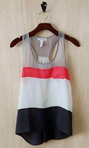 This tank combines feminine and playful, high and low style with a nice loose drape perfect for the summer heat or for layering. Dress it up with slim pencil skirt or down with denim.