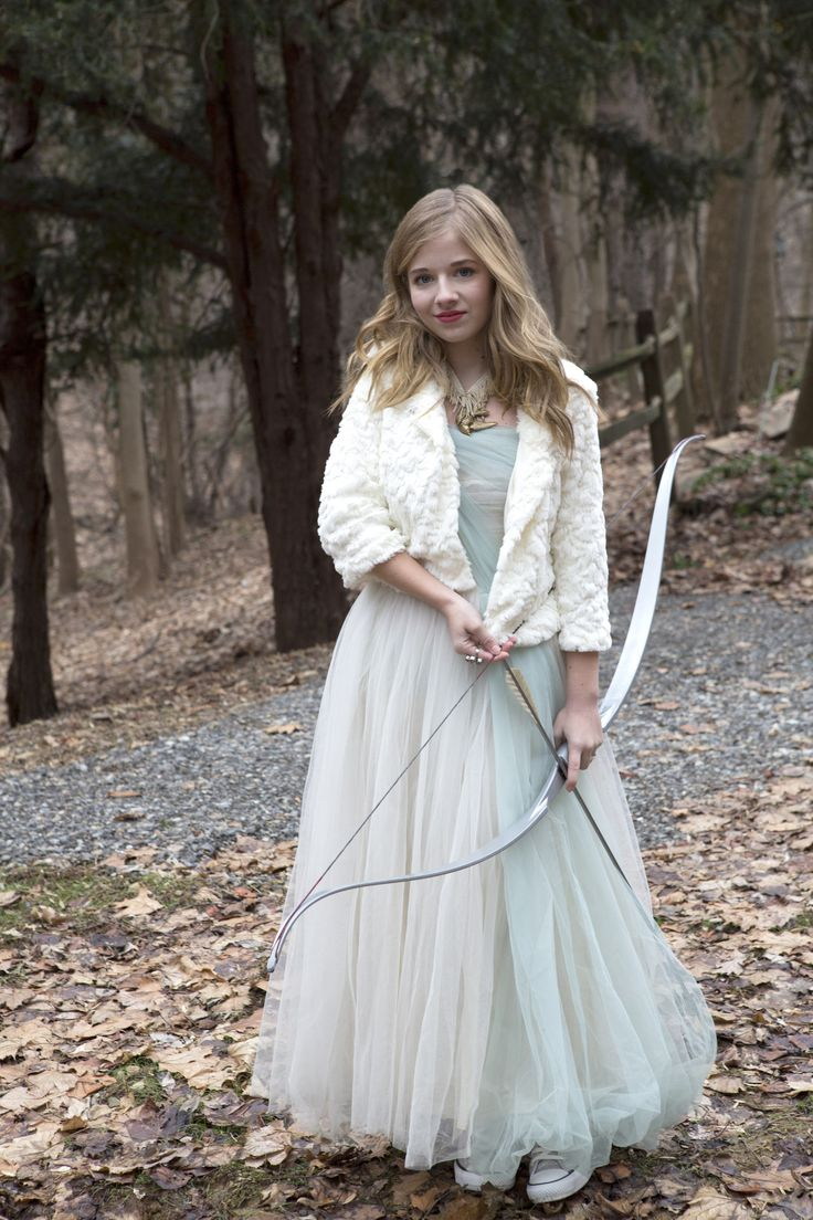 Jackie Evancho modeling a bow and arrow during her Anna Wolf photo shoot.