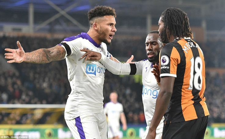 Dieumerci Mbokani (right) was sent off for Hull after an altercation withNewcastle captain Jamaal Lascelles (left)