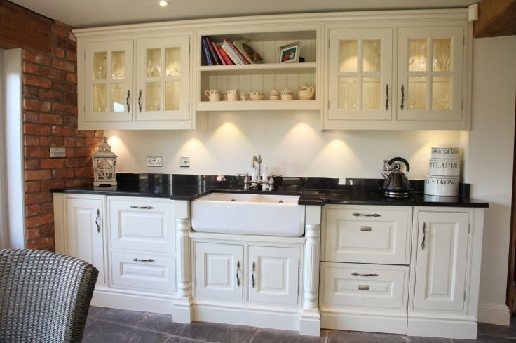 Traditional Georgian Kitchen in white. Traditionally styled this kitchen features our Georgian bar glass fronted wall cabinets with tongue & grooved backs, fluted mullions around the Belfast sink and Range cooker and torus plinths.