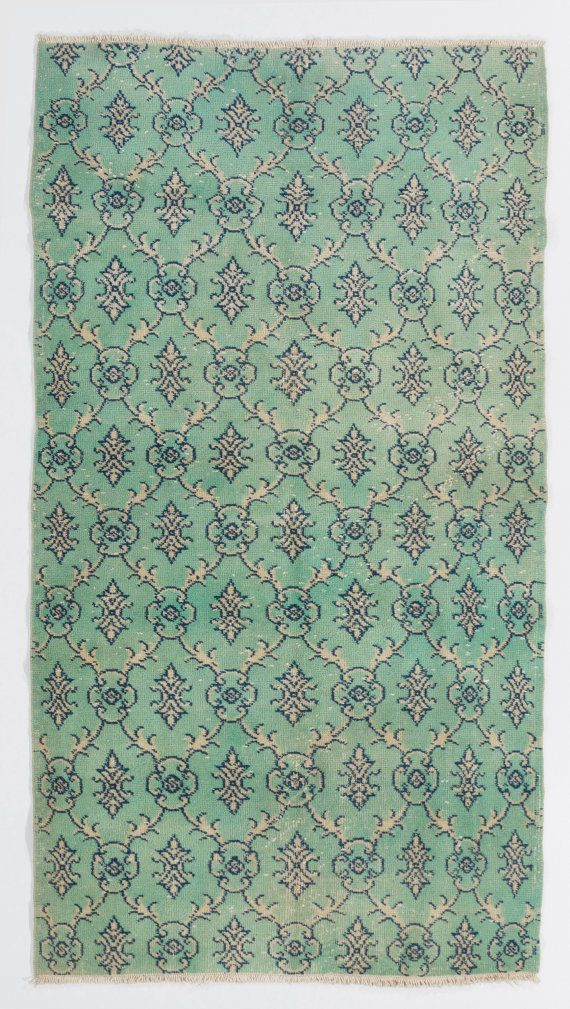 A vintage hand-made Anatolian rug in turquoise color. Low wool pile on cotton foundation, finely hand-knotted. Sturdy and as clean as a brand new rug.   We also wholesale and custom produce rugs, please feel free to contact for any inquiries. Thanks   Size: 110x203 cm, Y277