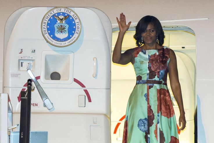 U.S. first lady Michelle Obama waves as she arrives at Siem Reap International Airport in Siem Reap March 20, 2015. Obama is on a visit to Cambodia to promote Let Girls Learn, a worldwide initiative that aims to help adolescent girls attend school. Obama, while in Cambodia, and Bun Rany, the First Lady of Cambodia, will meet with high school students and hear directly how they benefit from community-led programs like the Peace Corps, according to the White House. REUTERS/Athit Perawongmetha…