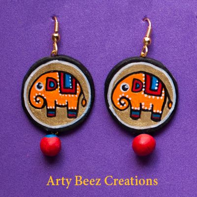 Beautifully colored in Yellow,red & blue in a contempoary taste and a unique elephant design, terracotta earrings to fabulously beautify your look !! Simple and elegant and would add charm to your traditional and casual attires eqaully !! One of the few accessories to make you look unque in the crowd. Handle with care! Disclaimer :- The images and final product will differ 10-15%