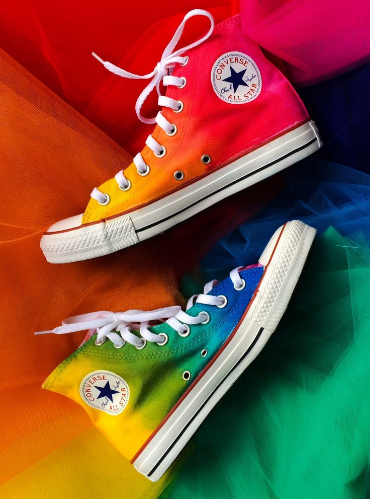 Taste the rainbow with these custom dyed Converse! No two pairs are alike, but that's what makes them, and YOU unique!Your converse will not look exactly like the converse pictured, because these are hand dyed with a brush and the color blend and order of colors is done randomly to ensure that no two pairs look alike.I offer a wide array of colors and the base colors I use for all pairs are indicated with a star.  Sometimes I may add in another color listed, or I can use...