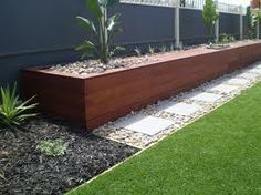 colorbond monument wall with merbau - Google Search