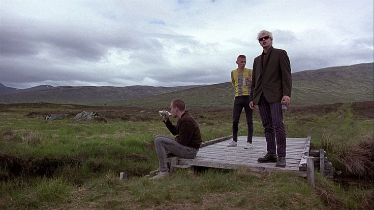 A Picture of three of the main characters in a field