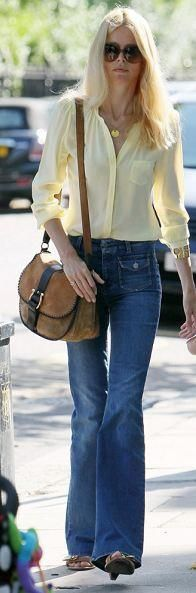 Who made Claudia Schiffer's yellow button down top, brown sandals, blue jeans and handbag? Jeans – Stella McCartney  Purse – Ferragamo  Shirt – Whistles  Shoes – Mulberry