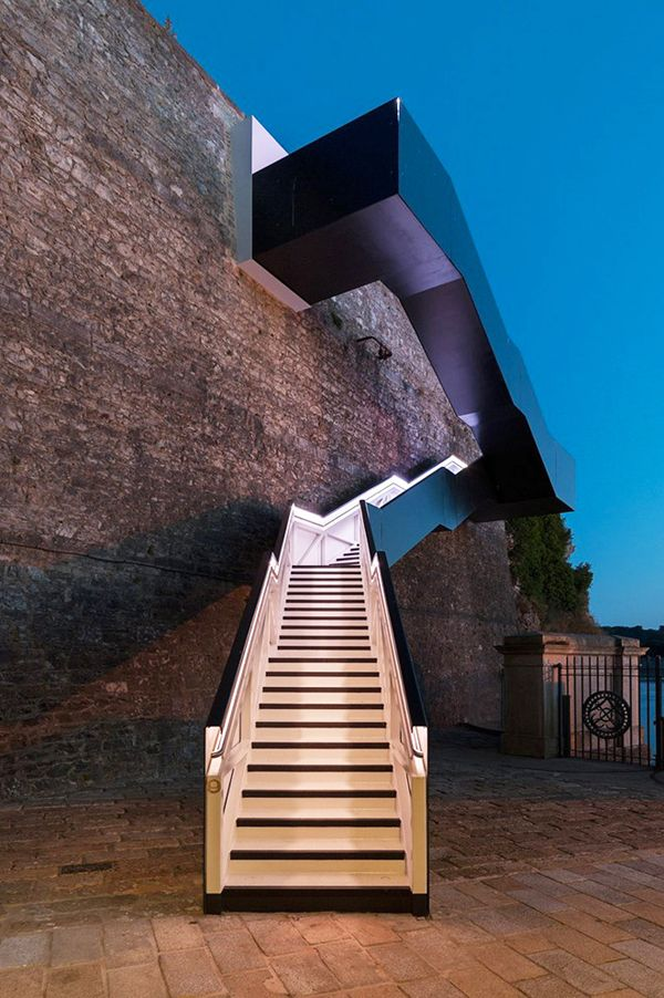 A Colorfully Illuminated Outdoor Stairway Lights Up A Historic Dead End