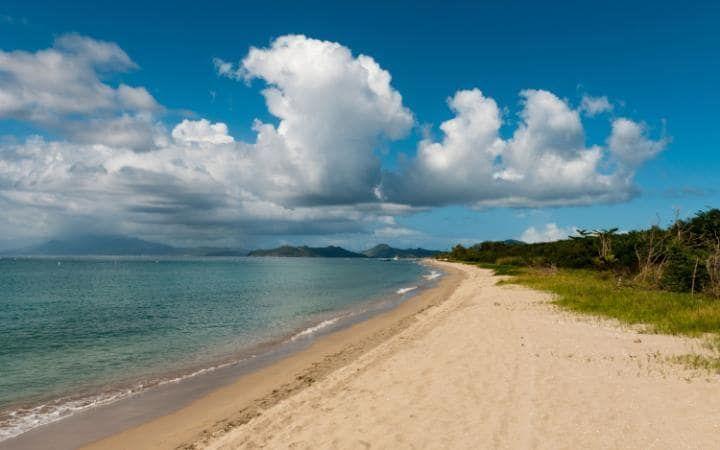 Pinney's Beach, Nevis//Pinney's Beach, also spelled Pinneys Beach, is a very long sandy beach on the western (Caribbean) coast of the island of Nevis, in Saint Kitts and Nevis, Leeward Islands, West Indies.