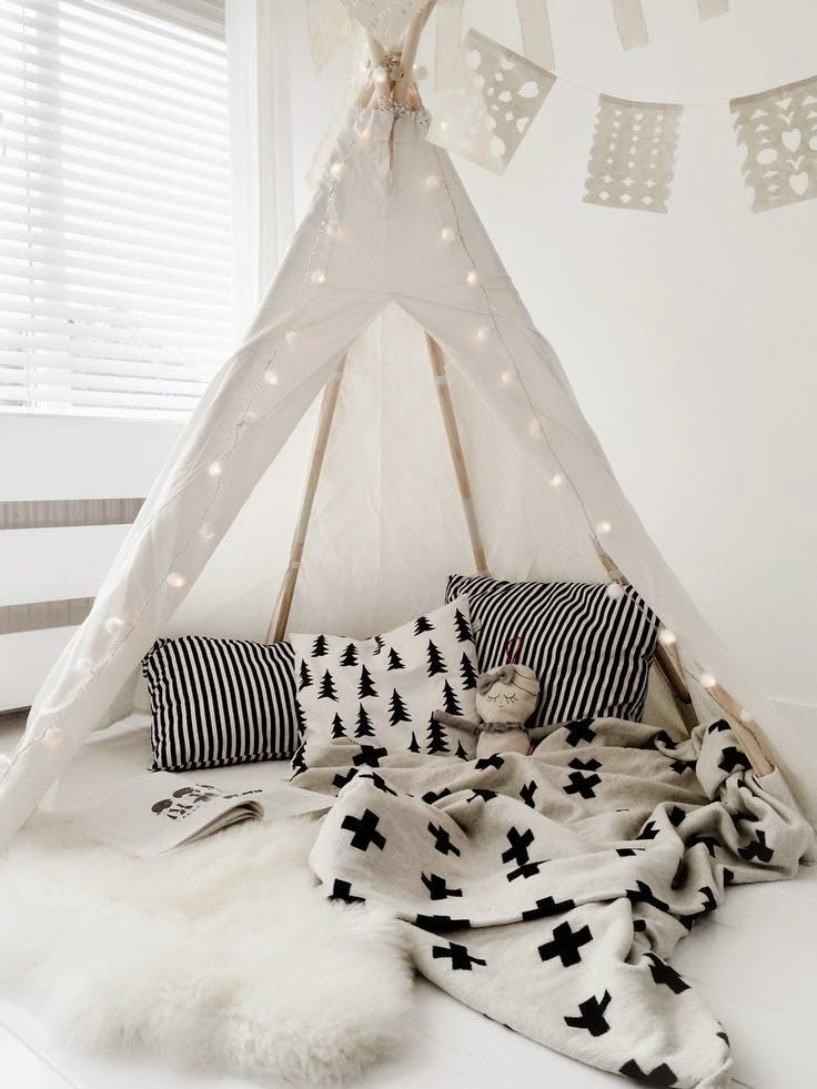 Teepee reading nook with clean colors, patterns, and lantern lights