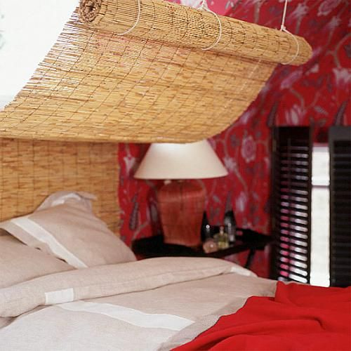 This is a great, inexpensive headboard and canopy combo! It works with lots of styles, such as the one shown here, and would also look really great with a tropical or beach theme.