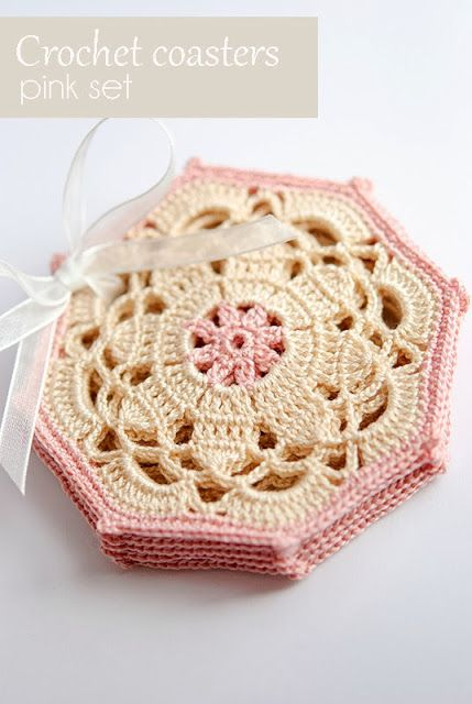 Crochet coasters set - would make a pretty heirloom afghan with small squares in between motifs.