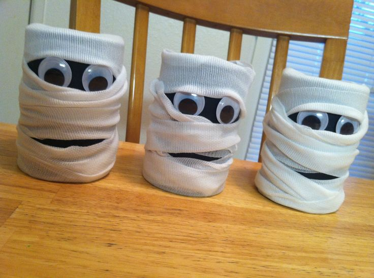 Mummy Candy Containers made from tin veggie cans, gauze, & googley eyes.