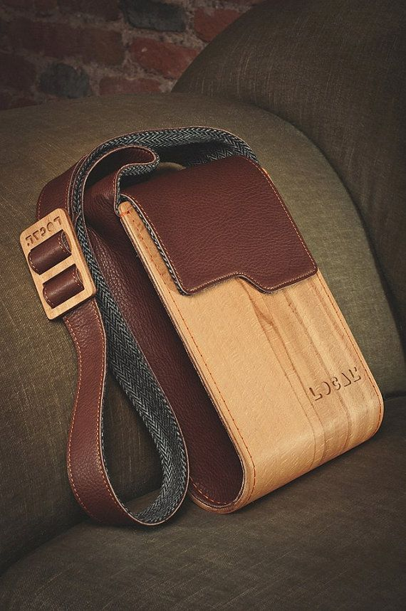 This is the one i like most .A combination of wood and leather  . The strap is a part of bag' sides . This one can be totally handmade .