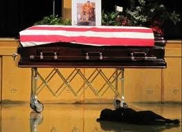 My Hero is gone…Navy SEAL Jon Tumilson lay in a coffin, draped in an American