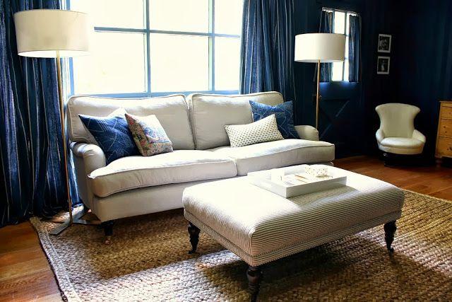 English roll arm sofa and ticking stripe ottoman in my dark blue den