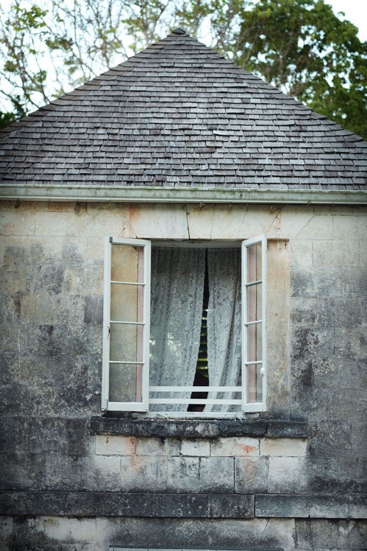 Lace curtains and open windows