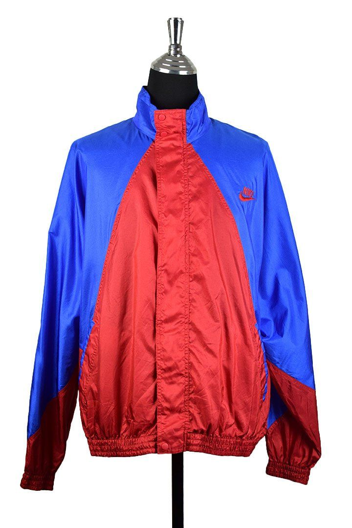 Nike Brand Spray Jacket :  Vendor: RetroStar Vintage ClothingType: JacketsPrice: 55.00  Nike brand spray jacket  Red and blue panels  Embroidered red logo to front left chest  Enclosed zip with press studs  Tagged size XL (Do not rely on tagged size. Please check measurements for actual size)  Chest: 68cm Length: 70cm