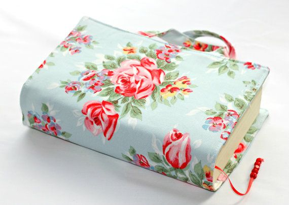 Blue red floral Cath kidston fabric book bag book cover with beaded bookmark, book wrap, book sleeve, fabric cover. $20.00, via Etsy.